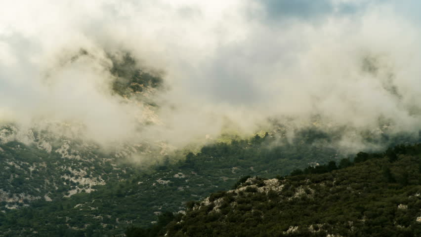 Time lapse of clouds building over a mountain peak in Fethiye, Turkey | Shutterstock HD Video #1009130450