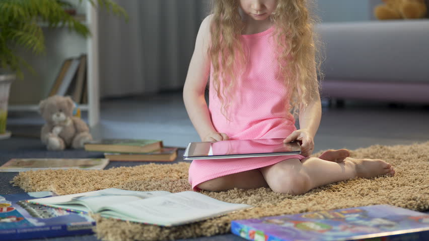 Happy child playing interactive educational game on tablet, using mobile app   Shutterstock HD Video #1009140200