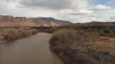 Aerial footage taken by a drone flying over the Colorado River toward the Grand Mesa, the world's largest flat-topped mountain!