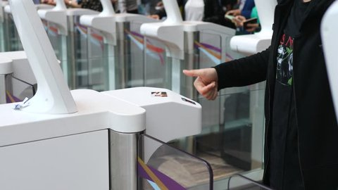 Passenger At Automated Customs Clearance Scanning Fingerprint In Airport.