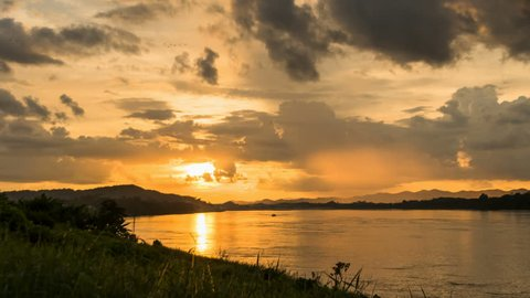 Sweet sunset over the Mekong River at the beach in Chiang Khan distric, Loei province, Thailand. 4k time lapse