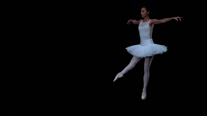Ballerina performing on black background in super slow motion