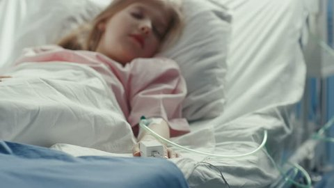 Cute Little Sick Girl Sleeps on a Bed in the Children's Hospital. Modern Pediatric Ward with Top Quality Health Care. Shot on RED EPIC-W 8K Helium Cinema Camera.
