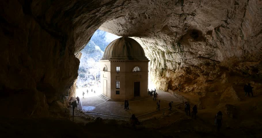 Tourists visiting Valadier Temple, the awesome stone sanctuary in Genga village besides Frasassi caves. Marche region, Italy.
