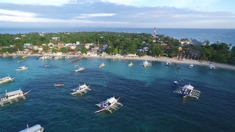 Malapascua island and Bounty Beach. It is part of the peninsular barangay of Logon, Daanbantayan, Cebu. Malapascua is a small island, only about 2.5 by 1 kilometre and has eight hamlets. Philippines