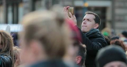 VIENNA, AUSTRIA - CIRCA JANUARY 2018 -  People taking photos with their cellphone camera device. Tourists filming with phone