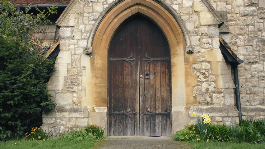 Beau Wooden Door Of An Old Stone Building.