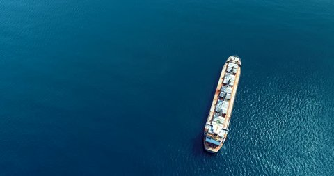 197 Aerial cinematic 4k with a bulk cargo ship and two large container ship at sea