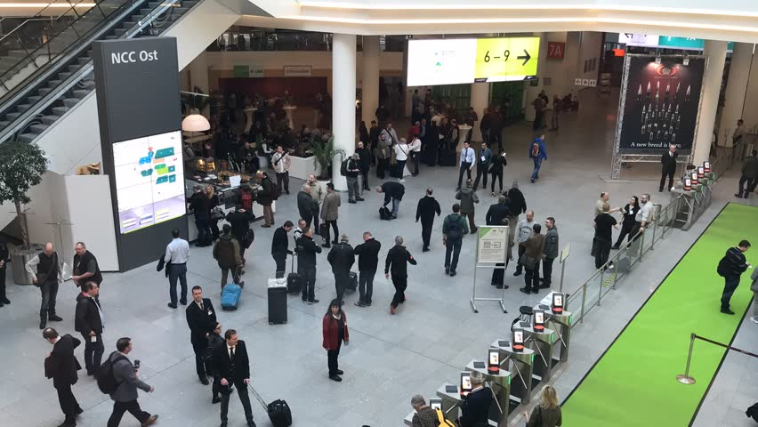 Nuremberg, Germany – MARCH 16: IWA gun exhibition is the most important gun show in europe on 2018 in Nuremberg. The main entrance of the ixhibition in NUremberg MESSE. | Shutterstock HD Video #1009403660