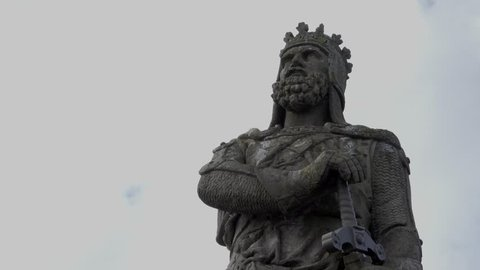 Stirling, Scotland, UK; March 24th 2018: Fast motion clouds behind a statue of Robert the Bruce, Scottish king.