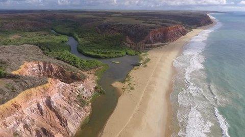 Aerial view of Lagoa Azeda Beach, a desert beach with coastal cliffs, in Jequiá da Praia city, 56km from Maceió, south coast of Alagoas, Brazil