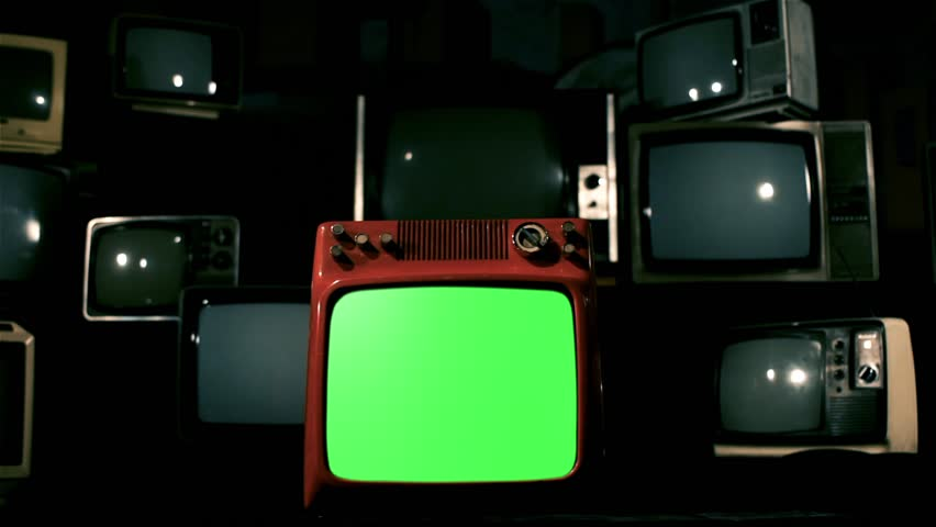 Old Red Tv Green Screen in the Middle of Many Tvs. Dolly Rolling In for a Close-Up. Fading Blue Steel Tone to a Black Background. | Shutterstock HD Video #1009488740