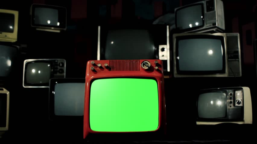 Old Red Tv Green Screen in the Middle of Many Tvs. Dolly Rolling In and Out for a Close-Up. Fading Iron Tone to a Black Background. | Shutterstock HD Video #1009488800