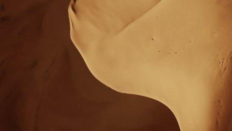 Aerial top view on sand dunes in Sahara desert at sunrise, Africa, 4k