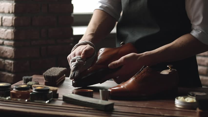 Shoe shop. Shoes master polishes boots | Shutterstock HD Video #1009533710