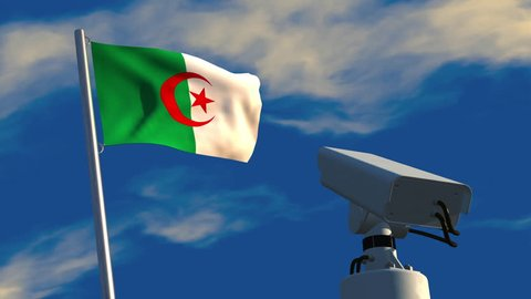 3D animation of a CCTV camera aimed at an Algerian flag then rotating to focus on the viewer; depicting increased use of video surveillance.