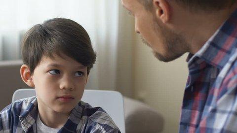 Dad scolds his son for bad behavior, discusses child discipline, remains calm