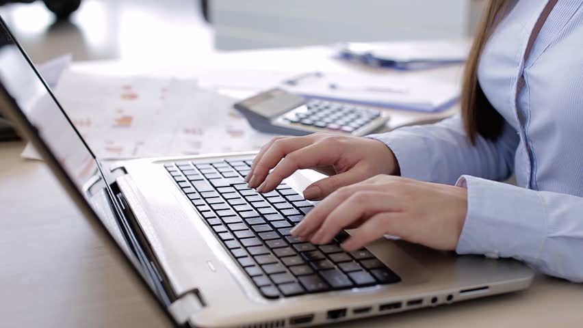 Young Business Woman Typing On Laptop | Shutterstock HD Video #1009651850