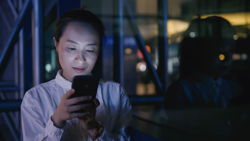 Asian businesswoman use of mobile phone at night | Shutterstock HD Video #1009680950