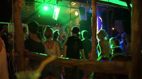 KOH PHANGAN - CIRCA 2018: People dancing at reggae concert in small cozy bar. Party
