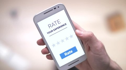giving a 5 stars rating review on a smartphone device.