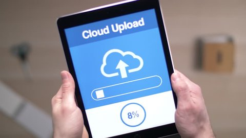 Uploading data to the cloud with a tablet device.