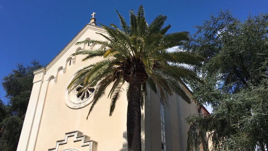Saint Jerome church and palm in Herceg Novi, Montenegro. 4K