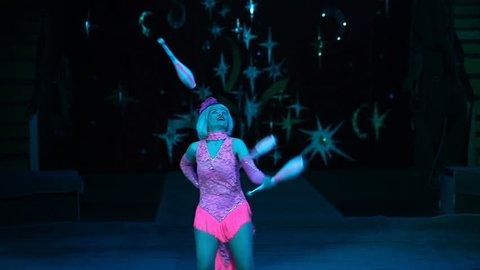 Juggler woman in the circus