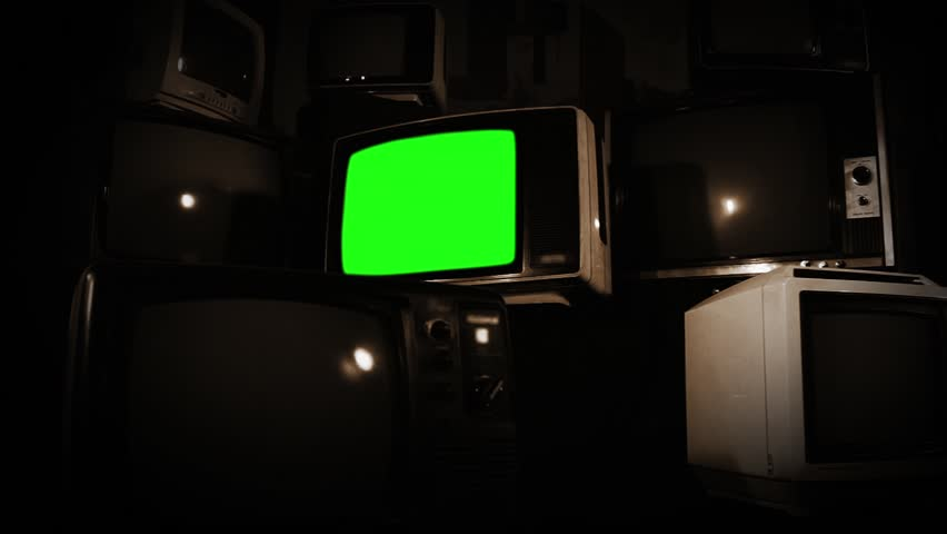Old Tv Green Screen with Many 1980s Tvs. Zoom Out. Sepia Tone. Ready to replace green screen with any footage or picture you want. | Shutterstock HD Video #1009773770