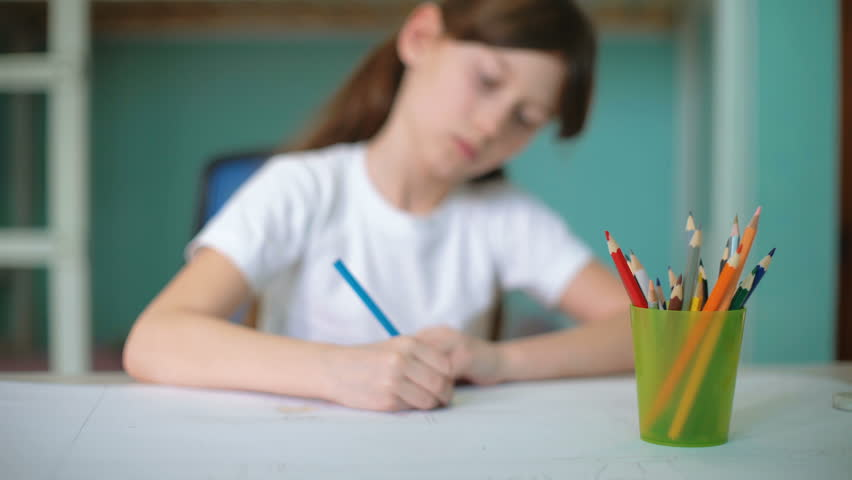 closeup girl hands sharpening pencil, cinemagraph, kid prepare to home exercise