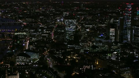 Aerial skyline view at night London city lights financial district modern skyscrapers Walkie Talkie Cheesegrater England United Kingdom RED WEAPON