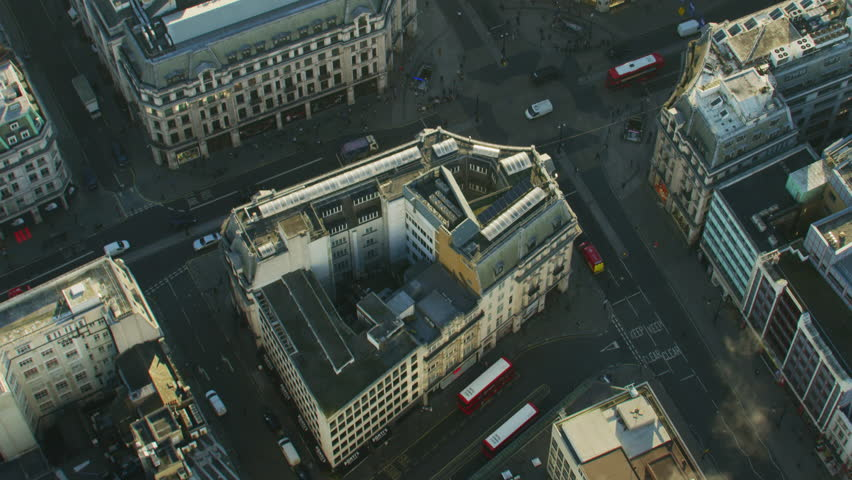 Aerial view at sunrise Oxford Circus buildings vehicle traffic and pedestrians City of Westminster London England UK RED WEAPON | Shutterstock HD Video #1009781360