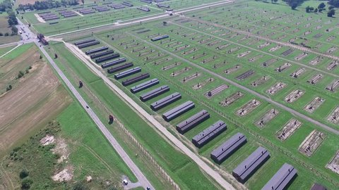 Aerial footage of Auschwitz Birkenau concentration camp, view os barracks and fence