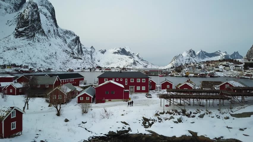 4k Aerial Drone Footage - 3 Tourists in Reine Norway, mountains of the Lofoten Islands