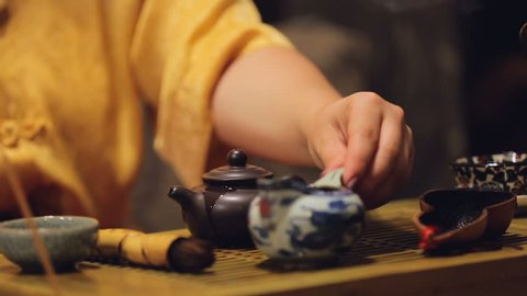 Exhibition of tea ceremony in asian restaurant, Chinese culture, set of rituals