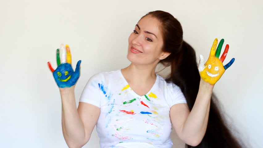 Girl painter student smiles and dances. Dirty clothes and dirty hands of the artist woman. Smile.Painting, art, creative | Shutterstock HD Video #1009823900