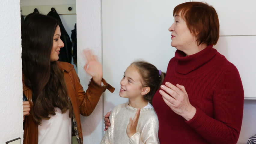 Happy young mother leaving daughter with grandma at home, saying goodbye | Shutterstock HD Video #1009838510