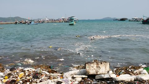 Trash, plastic, garbage, bottle... environmental pollution on the beach. Royalty high-quality free stock video footage of trash, plastic bottle on the beach. Waste that polluted the ocean environment