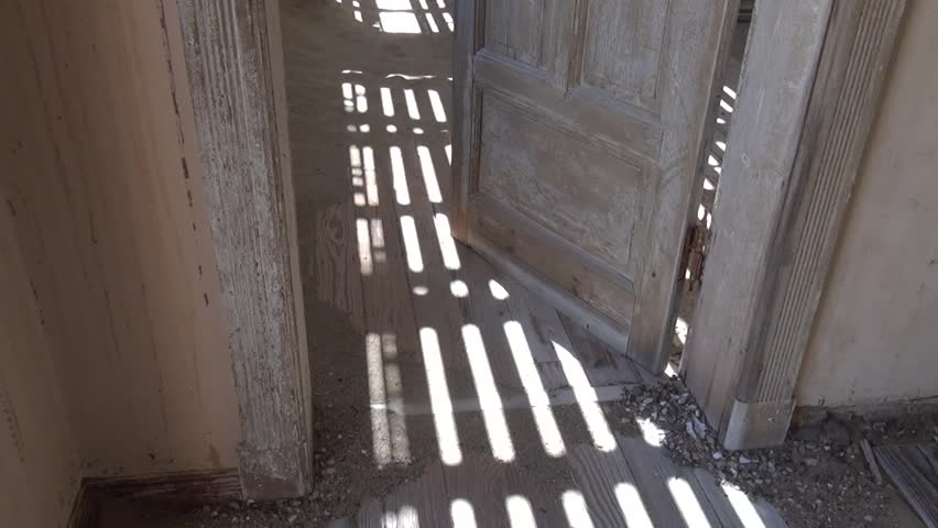 HD quality video of abandoned diamond mining town Kolmanskop, houses interior, located near coastal harbour town Luderitz in the Namib Desert Sperrgebiet area in south of Namibia, southern Africa