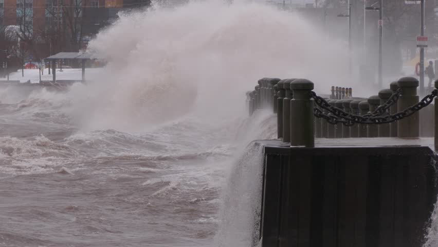 Massive waves crash into shore in typhoon and hurricane force wind storm   Shutterstock HD Video #1009893380