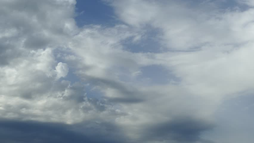 Natural background with dark stormy clouds before rain. Blue lagoon beach, Kassiopi, Corfu Island, Greece.