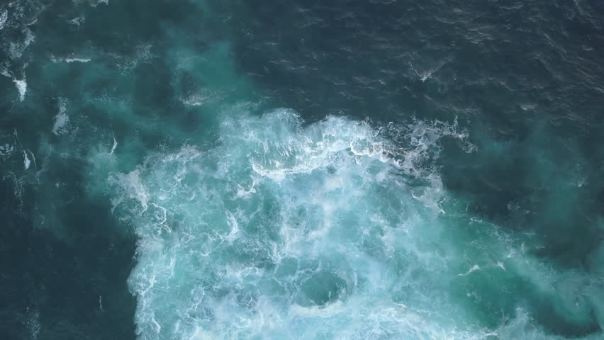 Aerial view of water open water forming foam on one side. | Shutterstock HD Video #1009910060