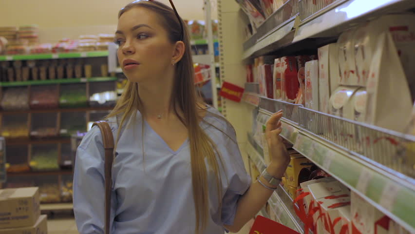 Pretty young girl in a mall, shopping | Shutterstock HD Video #1009963010