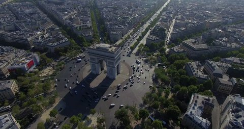 PARIS, FRANCE – SEPTEMBER 2016 : Aerial view over Triumphal Arc traffic on a beautiful day with view of central Paris cityscape