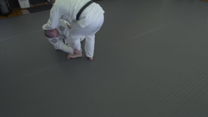 Mid adult men practicing Jiu-jitsu