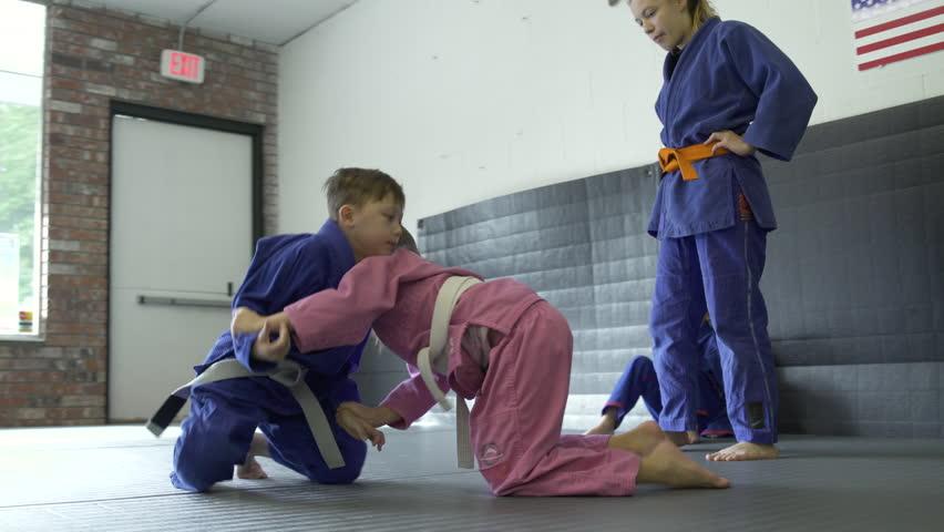 Children practicing Jiu-jitsu moves