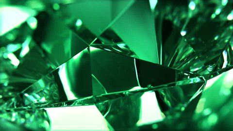 Close-up of slowly rotating green diamond. Seamless loop, nice looping background (4K,ultra high definition 2160p)