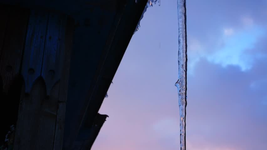 Dripping icicles, melting Icicles, Icicle hanging from roof, spring drops