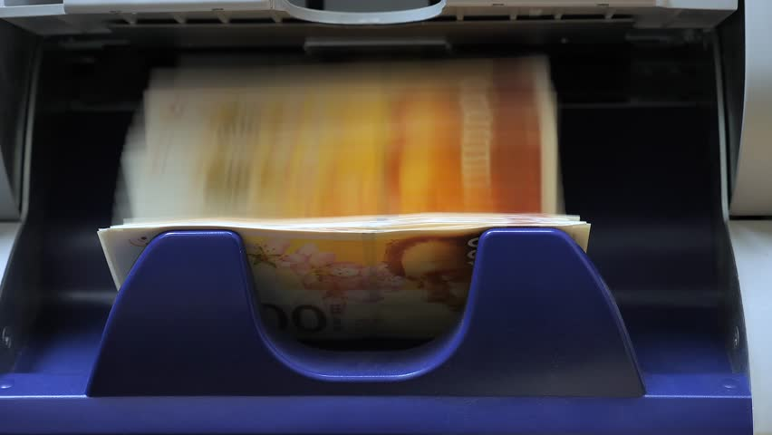 Israeli Shekel banknotes counted by a Currency counting machine  | Shutterstock HD Video #1010065550