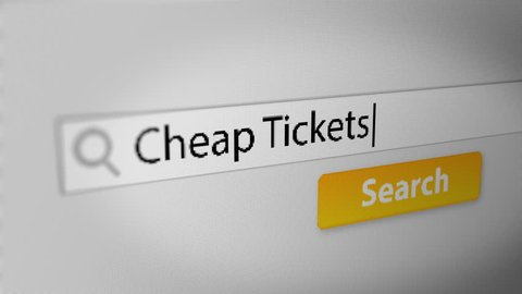 """""""Cheap Tickets"""" Typing into Search Engine on Computer Screen. Internet Search Engine Screen Close-Up."""